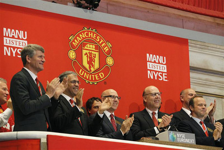Manchester United executives and owners ring the opening bell at the NY Stock Exchange (Reuters)