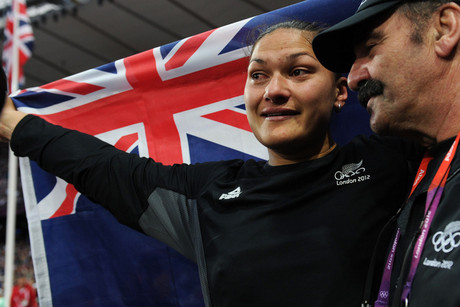 Valerie Adams is consoled by her coach Jean-Pierre Egger (Photosport)