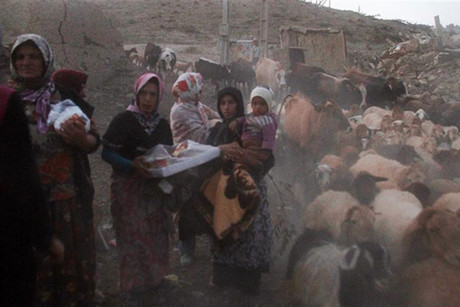 Earthquake victims in the town of Azerbaijan, Iran (Reuters)