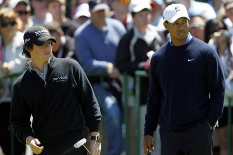 Rory McIlroy (L) is considered Tiger Woods' (R) biggest threat (Reuters file)