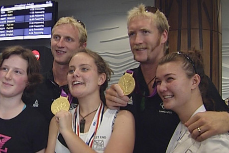 Hamish Bond (L) &amp; Eric Murray with fans at Auckland Airport