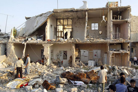 Houses destroyed during the air strike in Azaz (Reuters)