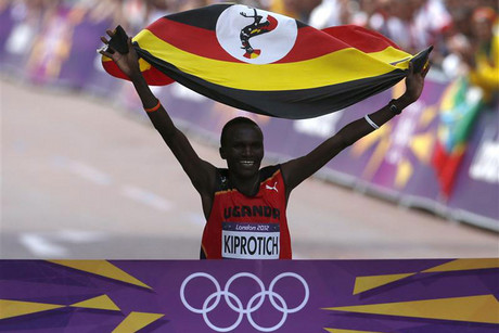 Stephen Kiprotich crosses the Olympics marathon finish line (Reuters file)
