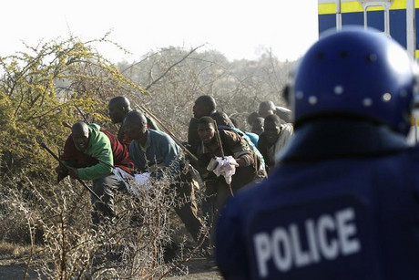 Protesting miners clash with police at Lonmin mine