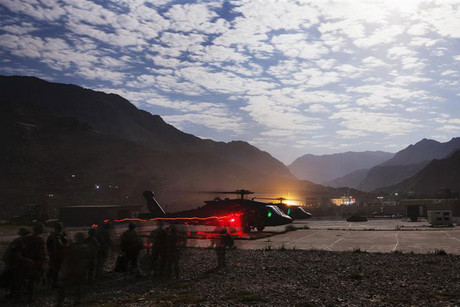 Two Blackhawk helicopters load passengers in the Pech River Valley of Afghanistan's Kunar Province (Reuters)
