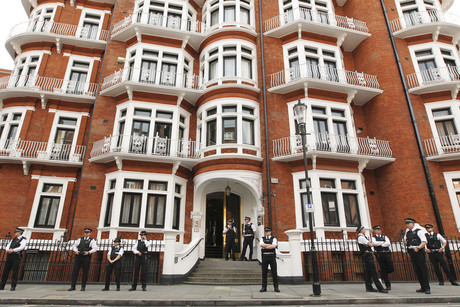 Police outside the Ecuadorian embassy in London (Reuters)