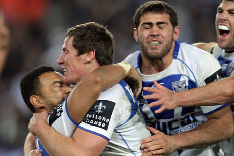 Bulldogs celebrate the last minute win during the NRL round 24, Canterbury-Bankstown Bulldogs v Wests Tigers in Sydney (AAP)