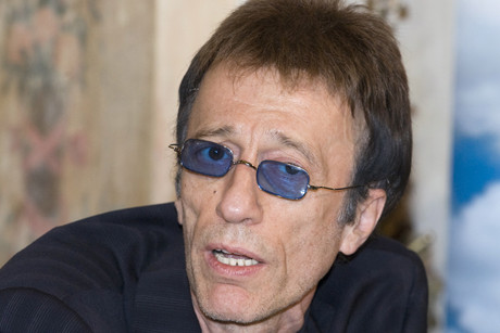 Former Bee Gees singer Robin Gibb speaks during a news conference in Moscow (Reuters)