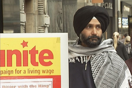 A Unite Union protester on Queen St this afternoon protesting migrant working conditions at Burger King NZ