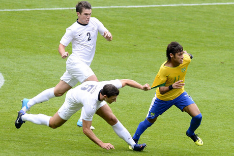 Tommy Smith of New Zealand tugs the jersey of Neymar (R) of Brazil during their men's first round Group C preliminary soccer match at the London 2012 Olympic Games at St James' Park in Newcastle (Reuters/Nigel Roddis)