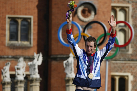 Gold medallist Britain's Bradley Wiggins celebrates on the podium during the victory ceremony for the men's cycling individual time trial at the London 2012 Olympic Games at Hampton Court Palace (Reuters/Paul Hanna)