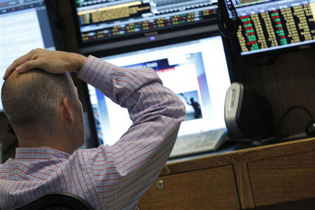 A trader watches his screens on the floor of the New York Stock Exchange (Reuters)