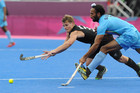 New Zealand's Steven Edwards collides with Sardar Singh during the Mens Hockey match, New Zealand v India at Riverbank Arena (Reuters)