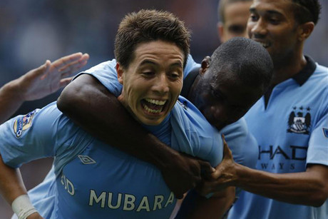 Manchester City's Samir Nasri, left, celebrates with Yaya Toure (Reuters)