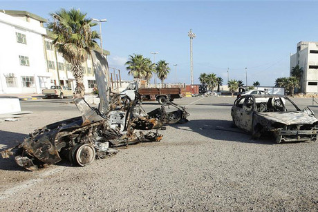 Damaged cars after one of the explosions in Tripoli (Reuters)