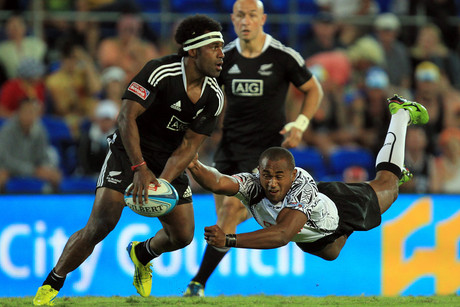 New Zealand's Tomasi Cama is tackled by Fiji's Ilai Tinai in the Gold Coast Sevens (Photosport)