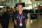 Lisa Carrington arrives at Auckland Airport with her gold medal (Photo: Imogen Crispe)