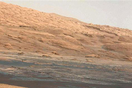 Handout photo of NASA's Curiosity Rover with view of Mt Sharp (Reuters)