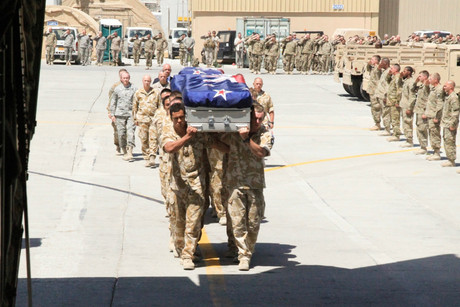 The three caskets are carried to the Royal Australian Air Force C-130 by members of the NZ Provincial Reconstruction Team.