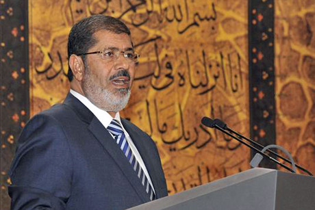 Egypt's President Mohamed Morsi speaks during the Laylat al-Qadr at Egypt Al-Azhar Conference Center in Nasr City in Cairo (Reuters)