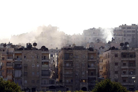 Smoke billows from buildings during clashes between Syrian rebels and pro-government forces in the Seif El Dawla district in the center of Aleppo city (Reuters/Youssef Boudlal)