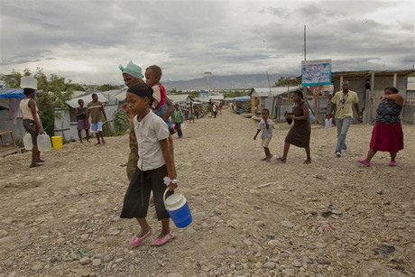 Residents of a camp for displaced people of the 2010 earthquake voluntarily evacuate in the wake of arriving tropical storm Isaac in Port au Prince (Reuters)