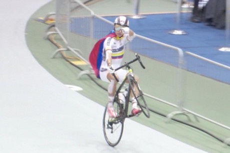 A Colombian rider does a victory lap after his win