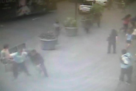 Surveillance footage shows people scattering as police gun down Jeffrey Johnson  (Reuters)