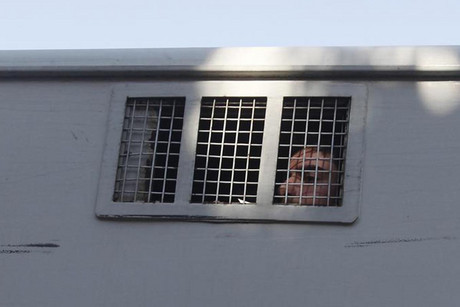 A dSyrian detainee looks out from a window  (Reuters)