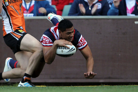 Daniel Tupou dots down for one of his three tries (AAP)
