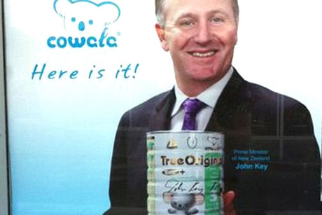 Prime Minister John Key pictured with the baby formula (Photo: supplied)