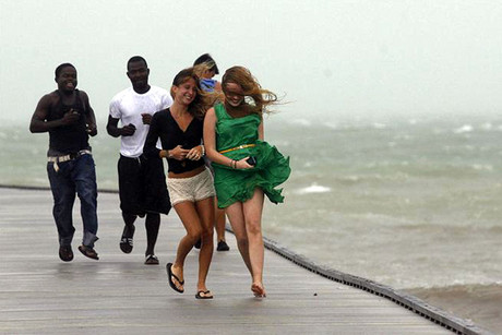 A group of people run back to shore along a pier in high wind and rough surf as Tropical Storm Isaac moves over Key West (Reuters/Andrew Innerarity)