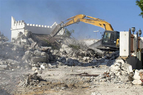 Libyan Salafis Muslims use a bulldozer to raze a Sufi mosque in central Tripoli (Reuters)