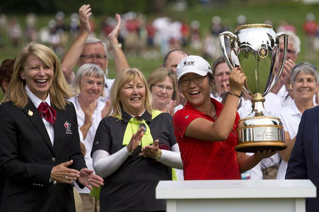 Ko holds the trophy after winning the LPGA Canadian Women's Open golf tournament in Coquitlam (Reuters)