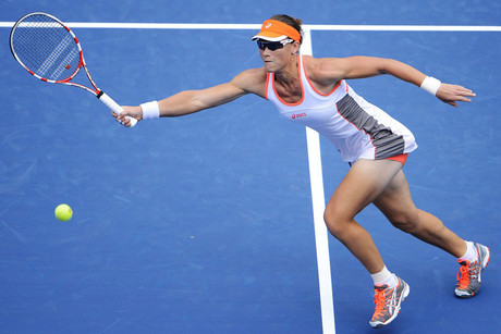 Samantha Stosur of Australia hits a return to Petra Martic of Croatia (AAP)