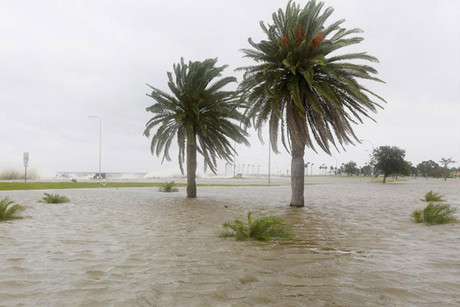 Water floods an area outside the levee system along the shore of Lake Pontchartrain as tropical storm Isaac approaches New Orleans (Reuters)