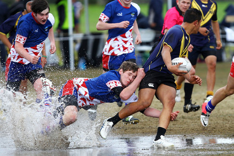 Garth Kinley pulls down Joshua Cullen Minhinnick at the New Zealand Secondary Schools National Rugby League Tournament (Photosport)