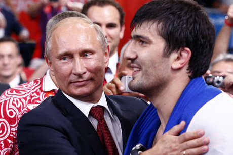 Vladimir Putin congratulates Russia's Tagir Khaibulaev after winning the men's -100kg final judo match (Reuters)