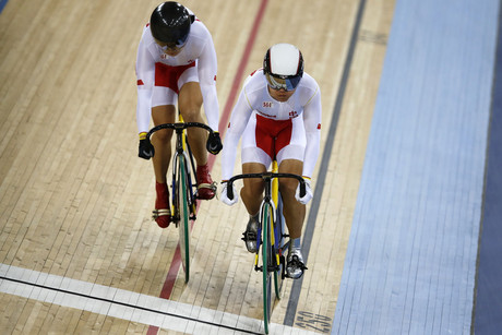 China's Gong Jinjie (R) and Guo Shuang compete in the track cycling women's team sprint qualifying heats at the Velodrome (Reuters/Phil Hanna)