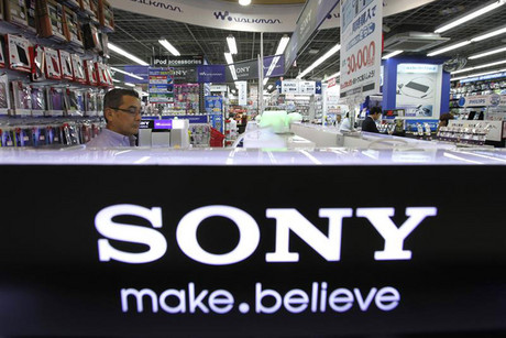 A man looks at Sony products displayed at an electronics store in Tokyo (Reuters)