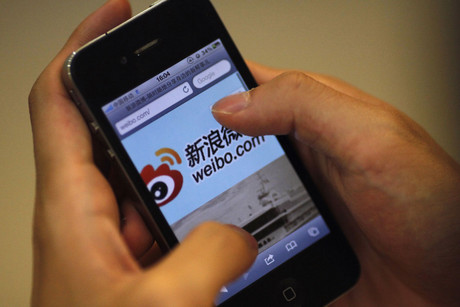 Sina Weibo on an iPhone (Reuters)