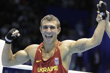 Vasyl Lomachenko reacts to his win at the London Olympics  (Reuters)