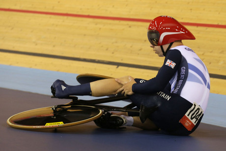 Britain's Philip Hindes sits on the ground as he waits for assistance after falling during their track cycling men's team sprint qualifying heats at the Velodrome during the London 2012 Olympic Games (Reuters/Cathal McNaughton)
