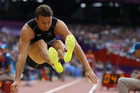 Brent Newdick does the long jump as part of the decathlon (Reuters)