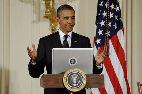 US President Barack Obama finishes using a computer to tweet (AAP)