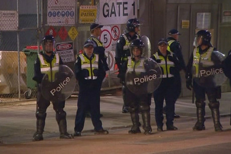 Police in riot gear at the Melbourne construction site