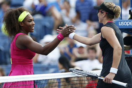 Serena Williams, left, is congratulate by Maria Jose Martinez Sanchez (Reuters)