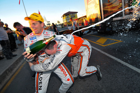 Craig Lowndes of Triple Eight Racing celebrating winning race 1 of the Coates Hire Ipswich 300 (NZN)