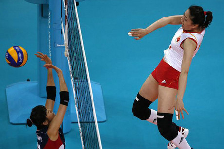 China's Ma spikes the ball against South Korea's Han (Reuters)