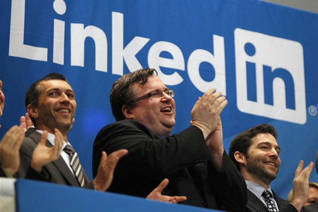 Linkedin founder and CEO applaud from bell balcony of New York Stock Exchange (Reuters)
